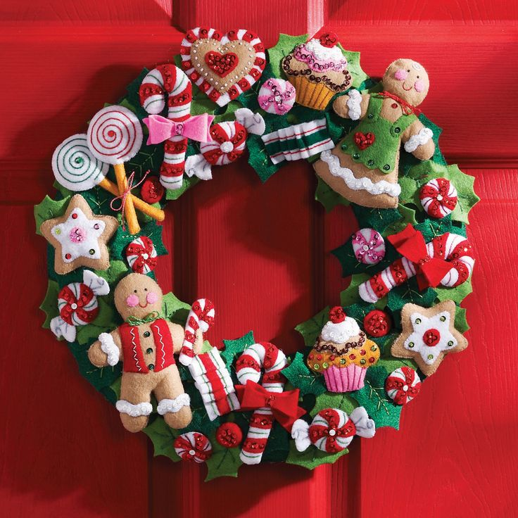 BUCILLA-Felt Wreath Kit: Cookies and Candy. Decorate your home for the holidays with this beautiful seasonal wreath. This kit contains everything you need to make one 15-inch wreath with candy decorations.