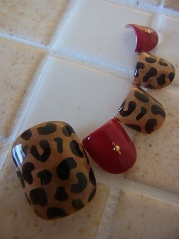 Leopard print with red pedi design