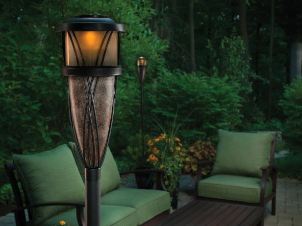 the flame and solar torch from tiki has a light that turns on at night as well as a torch and features a slate finish