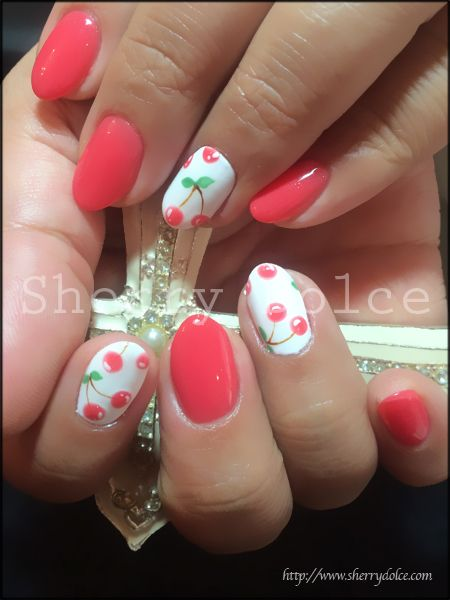 Pretty nails. These would be pretty with flowers instead of cherries