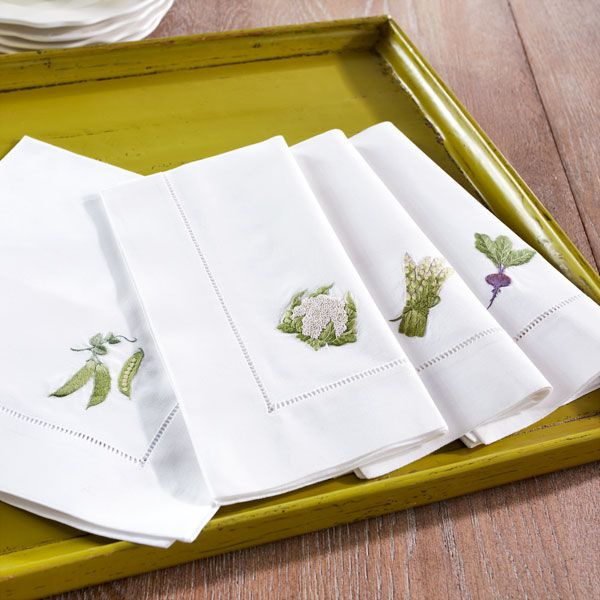 White linen napkins embroidered with vegetables. I found mine in a little shop near the Louvre but it seems Wisteria has them too.