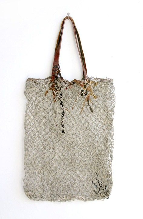 Fish net looking bag with leather handles. LOVE