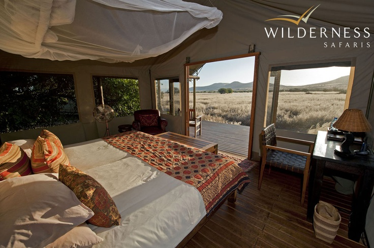 Desert Rhino Camp - An extension of the deck functions as a front veranda where guests can relax in director's chairs to take in the magnificent vistas of the surrounding desert and Etendeka Mountains. #Safari #Africa #Namibia #WildernessSafaris