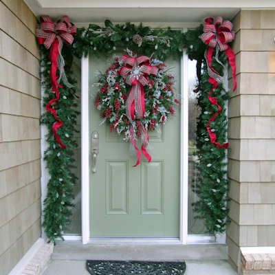christmas doorway decorated christmas door decorated with a lush garland and wreath. Black Bedroom Furniture Sets. Home Design Ideas