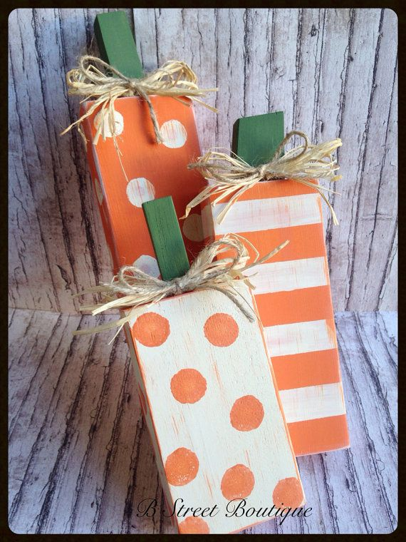This set of 3 wooden pumpkins are hand cut made from re-purposed wood. They are painted jack o lantern orange and ivory in polka dots & stripes.
