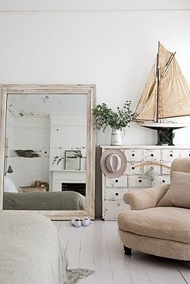 so many beautiful elements - mirror, chest, sailboat ❤