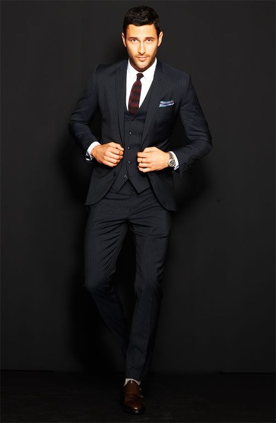 Noah Mills looking dapper in a three piece pinstripe suit. However, I prefer it when the pocket square matches the colour of the shirt or tie.