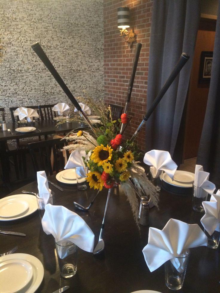 Golf Club centerpiece with Sunflowers wwwbroadwayflorist