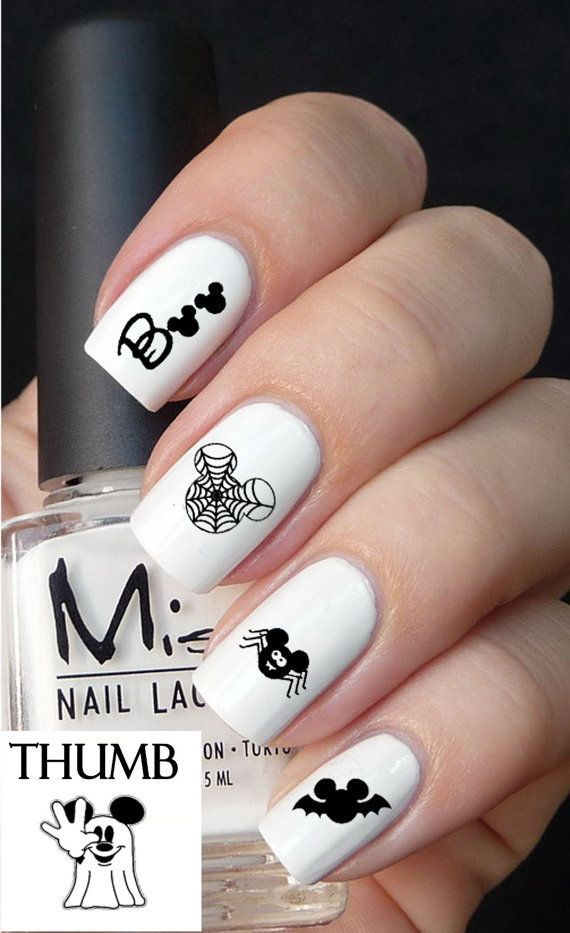 White nails with Halloween symbol