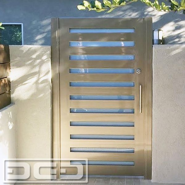 LA Modern Courtyard Gate in Metal & Glass by Dynamic Garage Door. Luxury entry gates made per your specifications. Call: (855) 343-3667 by DynamicGarageDoors