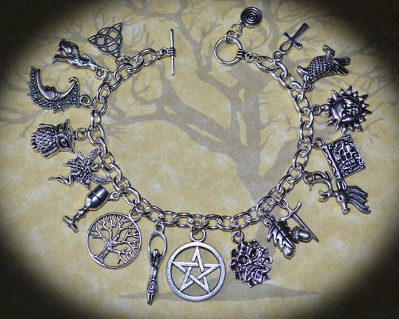 Hey, I found this really awesome Etsy listing at http://www.etsy.com/listing/159257364/the-pagan-ways-charm-bracelet-wicca