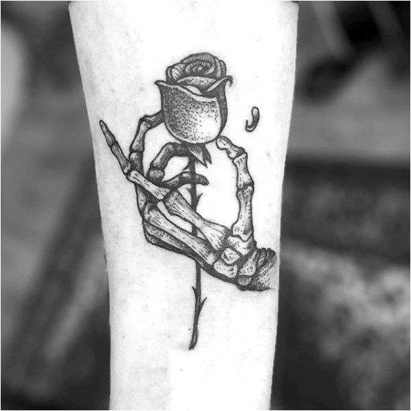 Skeleton Hand Holding Flower 75 Skeleton Hand Tattoo Designs For Men Moderntattoodesigns Click To See More Skeleton Hand Tattoo Tattoos Death Tattoo