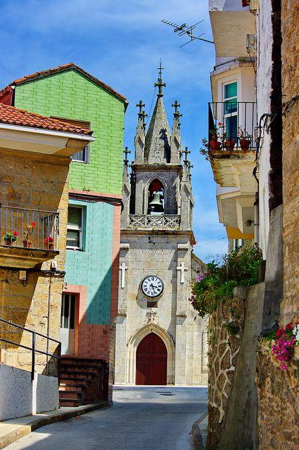 Corcubión, Galicia - Spain... love the church bell & flower balconies