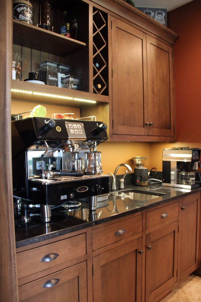 The owner of a coffee shop doesn't skimp when it comes to their home coffee bar. Filtered water, under cabinet lighting and a built-in Sub-Zero ice machine. Custom cabinetry by Ayr Custom Cabinetry includes pull-out wastebasket & built-in wine racks. Home designed and built by Martin Bros. Contracting, Inc.