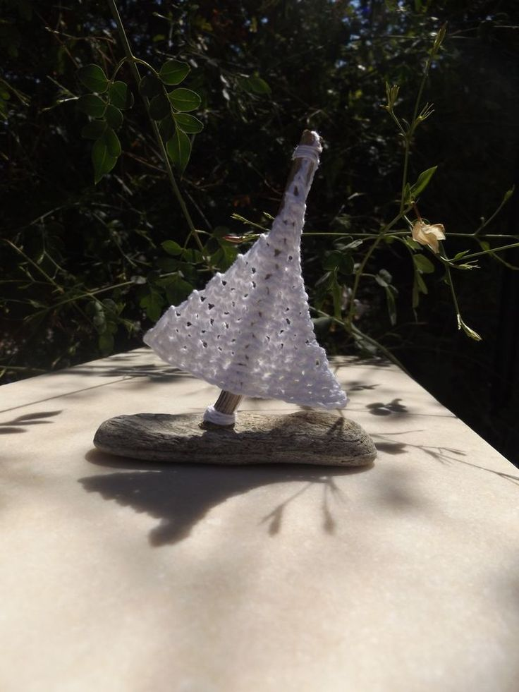 Handmade miniature sail boat from driftwood and beach pebble