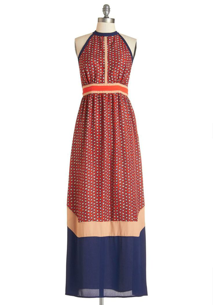 Making the rounds at a dinner party has never been easier in this marvelous maxi!