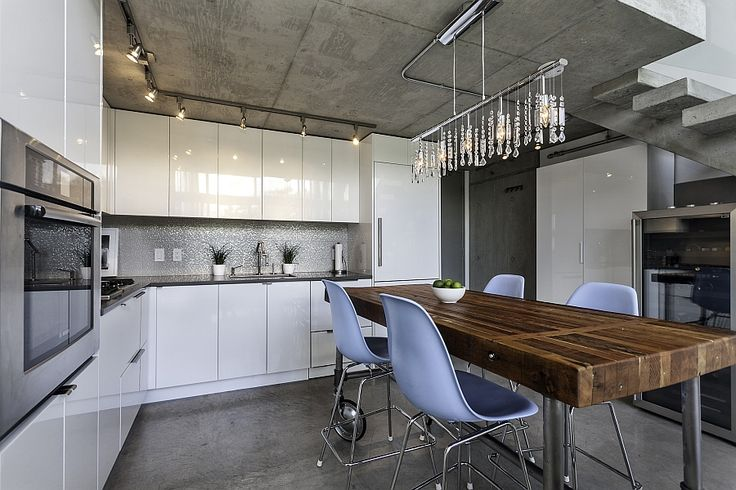 Smart cascading chandelier above the dining space enlivens the kitchen