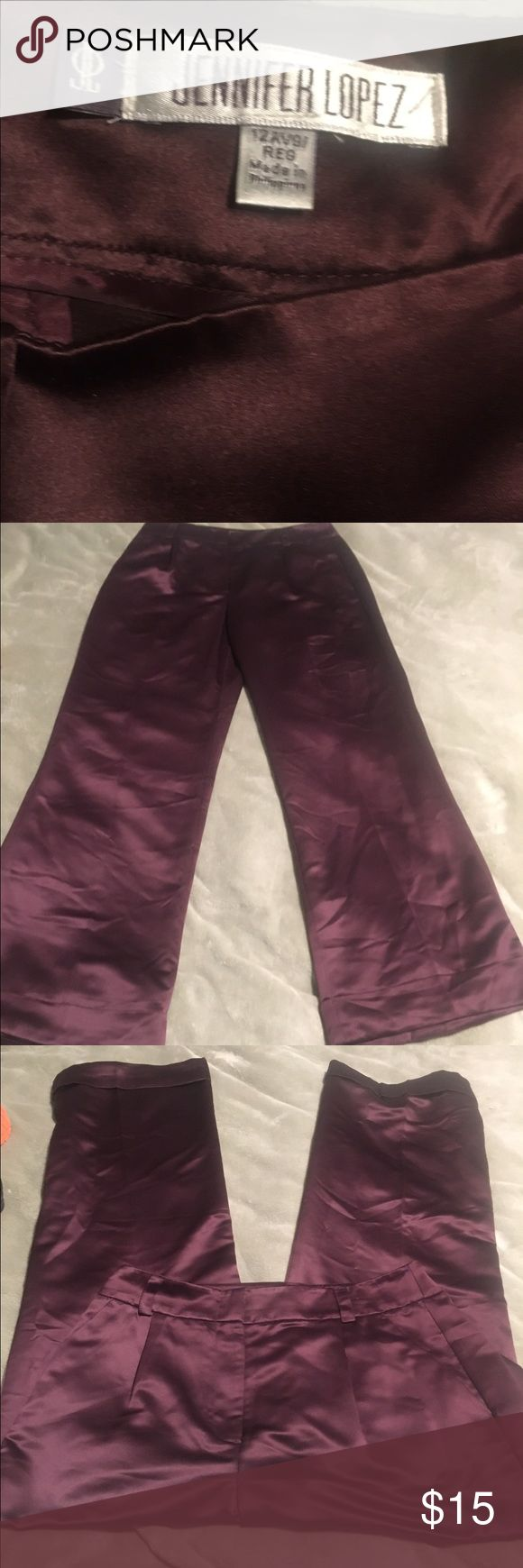 Jennifer Lopez burgundy palazzo pants. These pants are so stylish and comfortable. They are a beautiful rich burgundy color and have fake pockets ,  wide legs with cuffs and they zip up the front. size 12 average Jennifer Lopez Pants Wide Leg