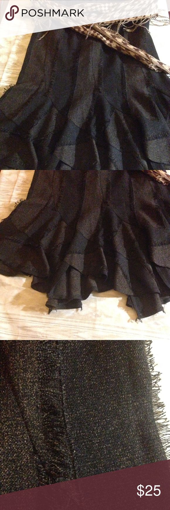 """Handkerchief Skirt This year """"Frayed"""" is in!  This well constructed skirt has a fluted silhouette that creates beautiful movement with each step you take. It has a concealed zipper in the back and is fully lined . Able to take you from the boardroom to the ballroom!  70% Polyester and 30% Rayon 31"""" long Skirts Midi"""