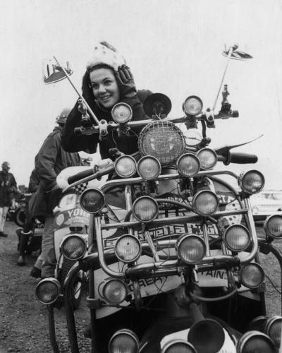 Nineteen year old Jill Roberts of Bournemouth adjusting her helmet before the start of the scooter rally organised by the Lambretta Club of Great Britain at Southend, 1966.
