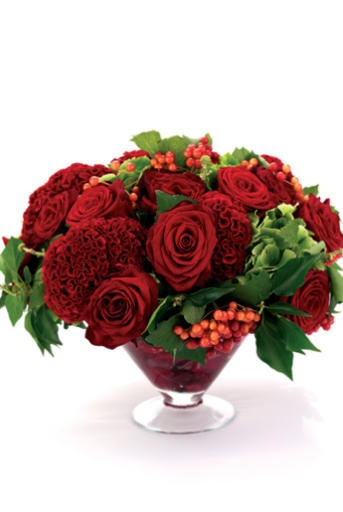Stunning red centerpiece of cockscomb, roses and berries.