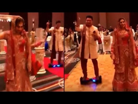 Viral Video Indian Couple Entering their Wedding on Hoverboard | Latest News | Stay updated for Latest News Video, Live Updates, Latest india news live today 2016, National News India 2016,  Today News, India News, Latest News, News in Hindi English, Bollywood 2016, Politics, Entertainment...