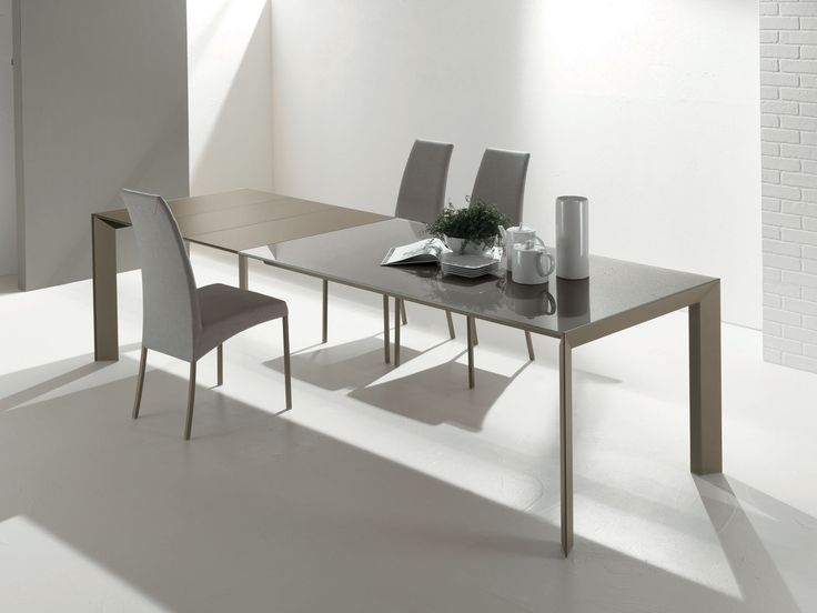 Extension Table Structured In Anodized Aluminum With Glass Or Laminate Top Parts Are Made From