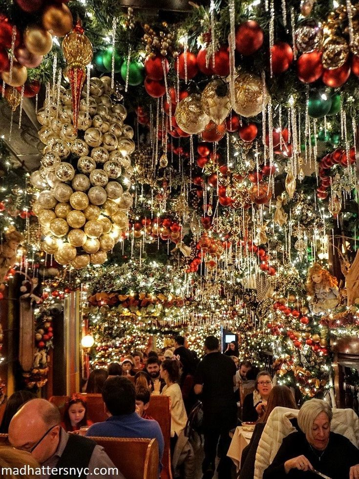 When Does Bloomingdales Ny Decorated For Christmas 2020 Colorful holiday decorations hanging from the ceiling at Rolf's
