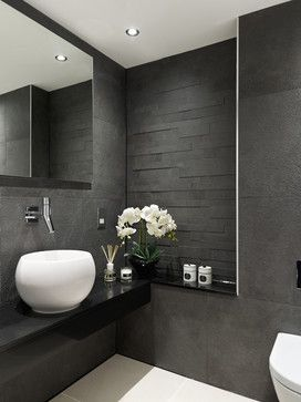 matt textured grey tiles and floating black granite basin vanity shelf || Park Road - contemporary - Cloakroom - South East - Concept Interiors
