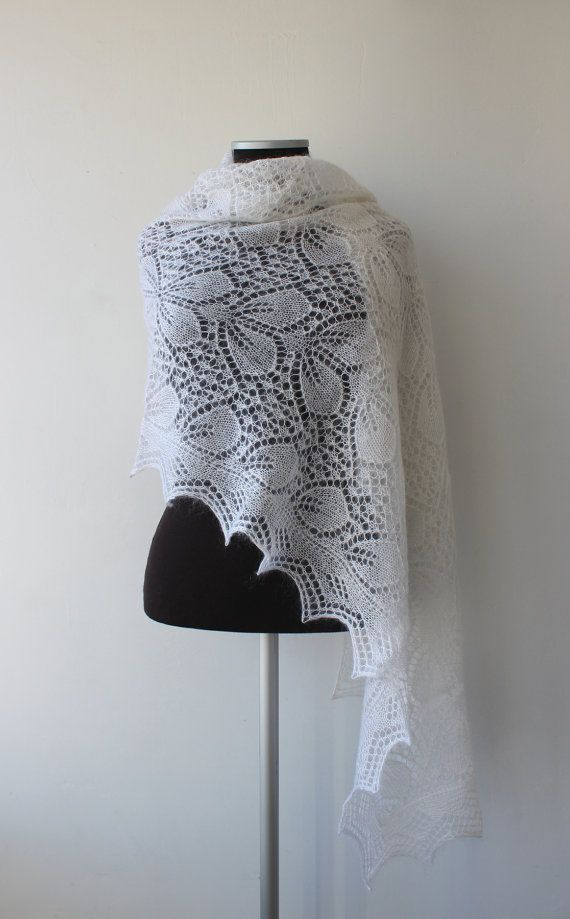 Beautiful lace shawl, made of very soft, luxury yarn-blend kid mohair and silk. This shawl is light, silky and extremely soft, very romantic and elegant. Will beautifully complement a white wedding dress, but it can also be worn on any other occasion. Wonderful gift idea for someone special or for yourself!  Ready to ship. From a pet and smoke free home. Colour: natural white Size approx: 75 х 23.5 (190 х 60 cm). Material: 70% Kid mohair, 30% Silk  Not exactly what youre looking for? More…