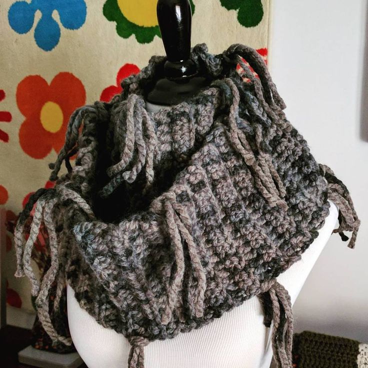 """Stand out from the crowd with this smokey blue and grey one of a kind tasseled infinity scarf. It's the perfect cold winter weather style maker.MEASUREMENTS:163 cm (64"""") in circumf..."""