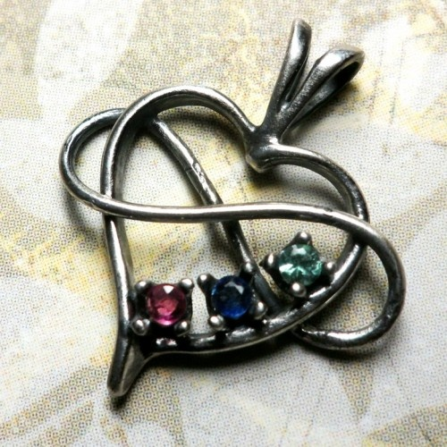Antiqued Birthstone Triad Heart - Polyamory Jewelry.  Got this for my birthday from my spices, it was beautiful and awesome!!  From what I understand, the seller was great to work with too!