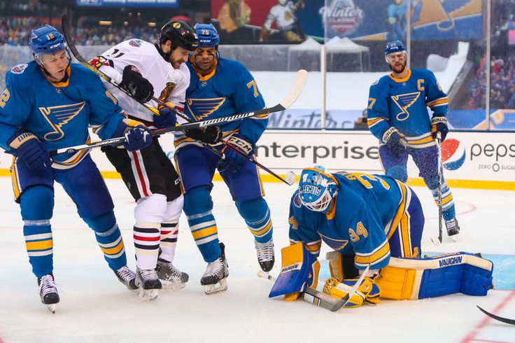 Blues vs. Blackhawks - 01/02/2017 - St Louis Blues - Photo Galleries  Goalie Jake Allen #34 of the St. Louis Blues covers the puck, as Andrew Desjardins #11 of the Chicago Blackhawks gets physical with Jori Lehtera #12 and Ryan Reaves #75