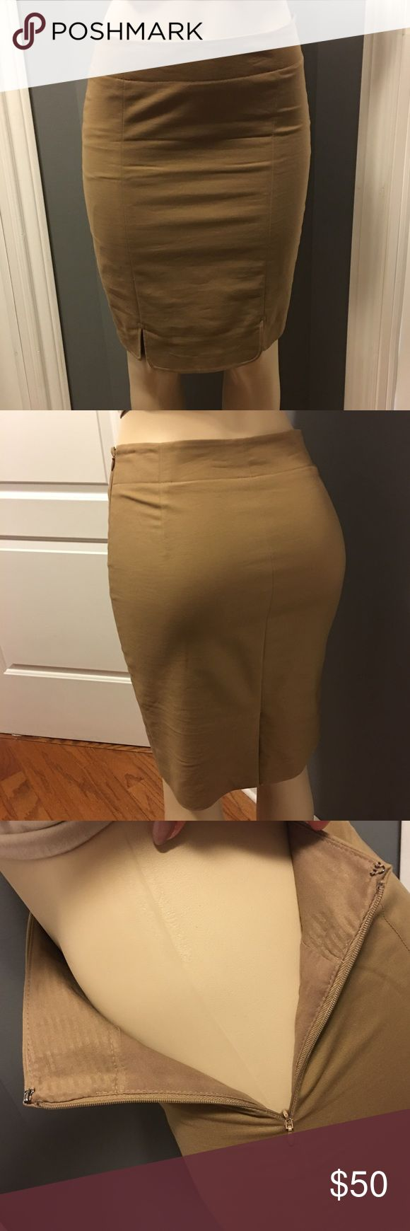 Women's Midi Skirt Sz2 Limited Khaki Lined LikeNew Great Lined Khaki Midi Skirt. Like New. Fully Lined. Size 2. Zip side closure. Slit at back and 2 on the front. Moderate stretch for a great fit The Limited Skirts Midi