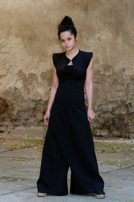 Great Black Jumpsuit with wide legs and low crotch. Amazing jumpsuit / dress that slims down your shape while framing a beautiful and firm shoulder line.