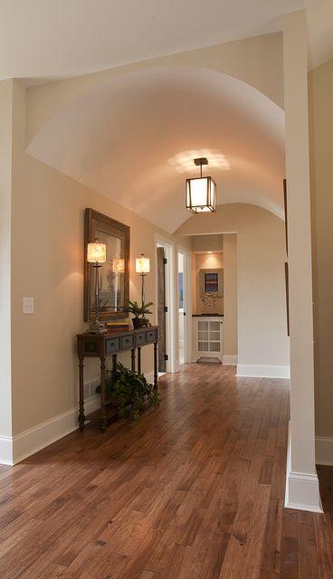 Pretty hallway idea. I love the ceiling.