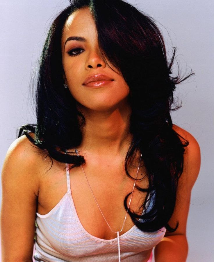Aaliyah. R.I.P. I remember I was in high school when her plane crashed taking her life. Everyone was heart broken.  She was such a talent and a great spirit. Here's to her 22 years on planet earth. Iba'ye....