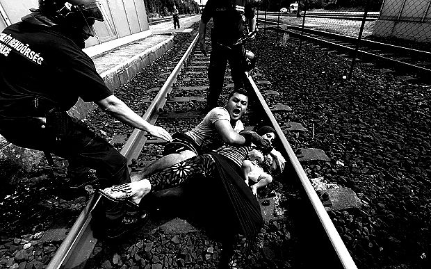 www.telegraph.co.uk A man throws his wife on to the train tracks in Bicske
