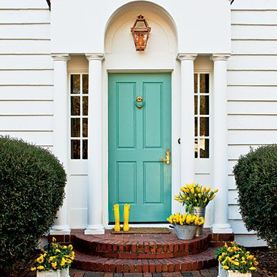 "Front Door: 1¾"" Fir HD Four Panel Door (EG5444), $532; tuckerdoor.com  Paint Color: Quarry (1342); prattandlambert.com  Light: Charleston Wall Mount Lantern with Electric 2-Light Cluster (CL01-CH-W), $249; frenchquarterlanterns.com"