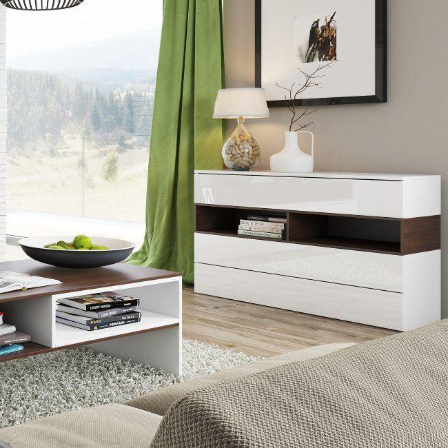 Diese hochmoderne Serie in hellen Farben bietet grenzenlose Möglichkeiten, große Räume mit minimalistischem Design zu arrangieren. Die einfachen Formen der Möbel schmücken jeden Innenraum und das schimmernde Weiß in Verbindung mit dunkler Malaga-Kirsche rundet das Design ab.