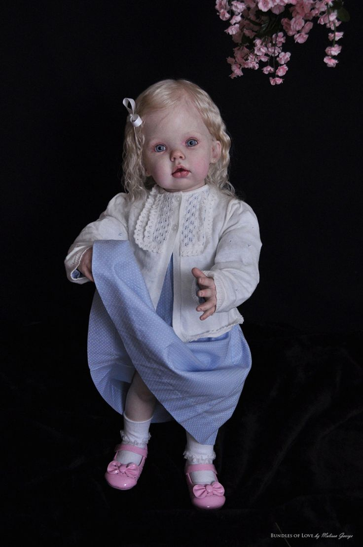 Reborn dolls look so real and take many hours to complete!  This one by Melissa George is exquisite.