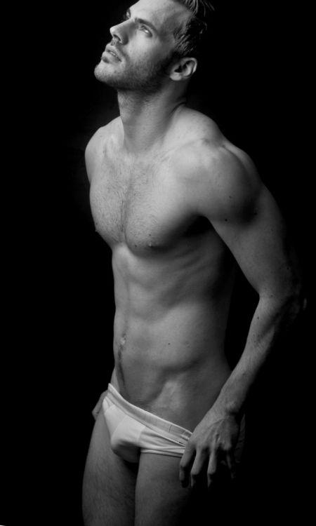 Men taking off underwear