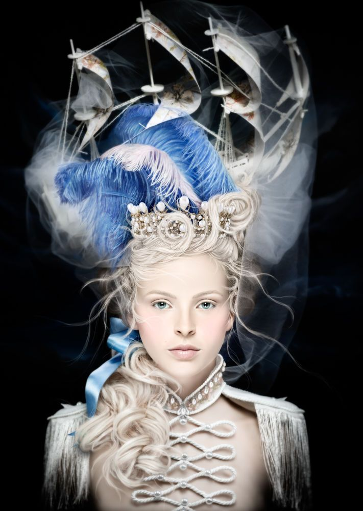 In this particular photo, called La Belle Poule, Alexia shows a modern day version of an extravagant headpiece Marie Antoinette wore of a model of a French ship of that name.
