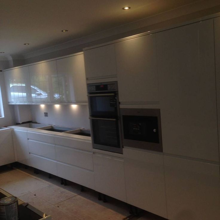 Knock through open planned kitchen quartz worktop built in appliances LED plinth lights amtico flooring induction hob wine cooler steam oven! #kitcheninstall #howdens #amtico #selfleveling #steelwork #welding