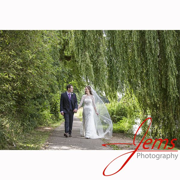 Romantic walk along the lake at St Nicholas Park and Abbey Fields Kenilworth nr Warwick. Capturing the love on their wedding day love this flowing natural image.