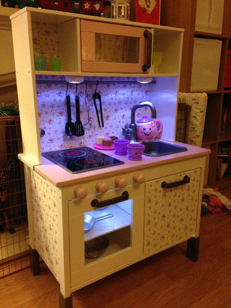 #ikeahackers ikea duktig kitchen makeover #ikeakitchen We painted it White & pink, added a backboard & patterned sticky back plastic. Push lights in the microwave, oven and over the sink & hob. Door knobs painted up for cooker dials.