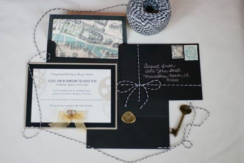 Any Francophile bride will love this très chic theme. A vintage map of Paris, a fleur-de-lis seal, and French stamps immediately set a sophisticated tone for this bridal shower. Plus: 9 Affordable Wedding Invitations from Etsy »
