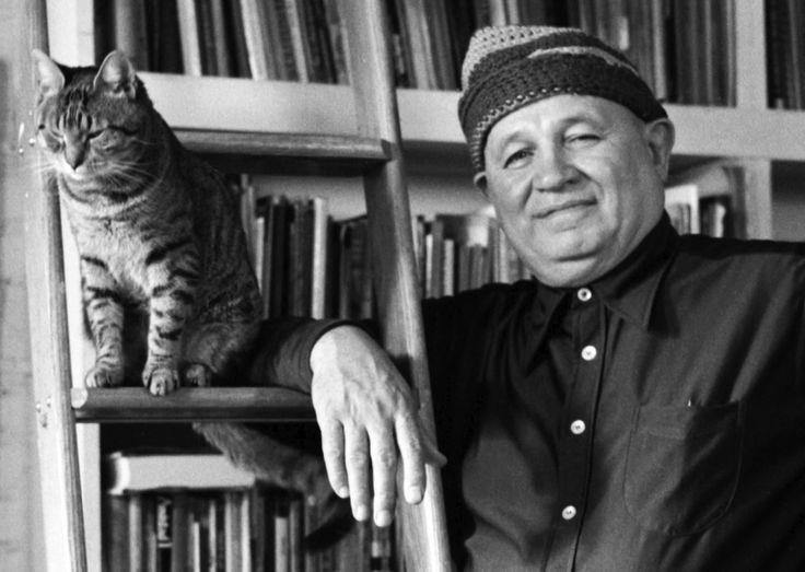 Romare Bearden with cat.