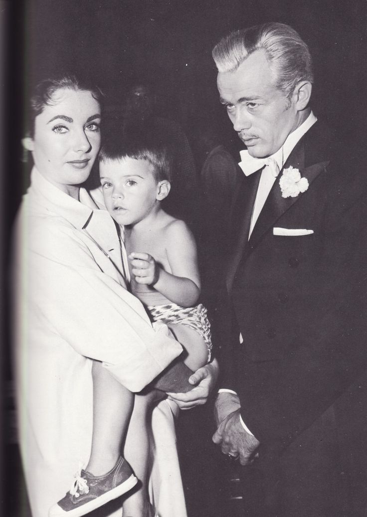 """Elizabeth and Michael Wilding Jr, with James Dean during the filming of """"Giant"""""""