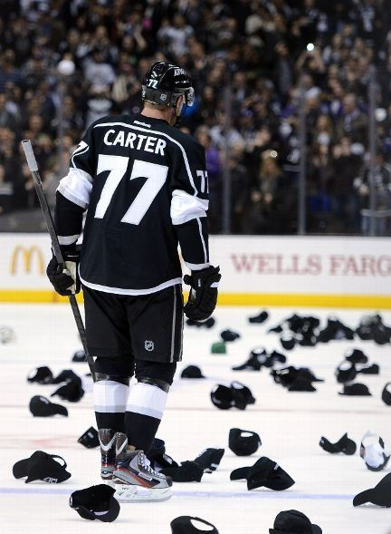 Jeff Carter #77 of the Los Angeles Kings skates as hats fill the ice in recognition of his natural hat trick for a 3-0 lead over the Nashville Predators during the third period at Staples Center on March 4, 2013 in Los Angeles, California. (Photo by Harry How/Getty Images)- ESPN
